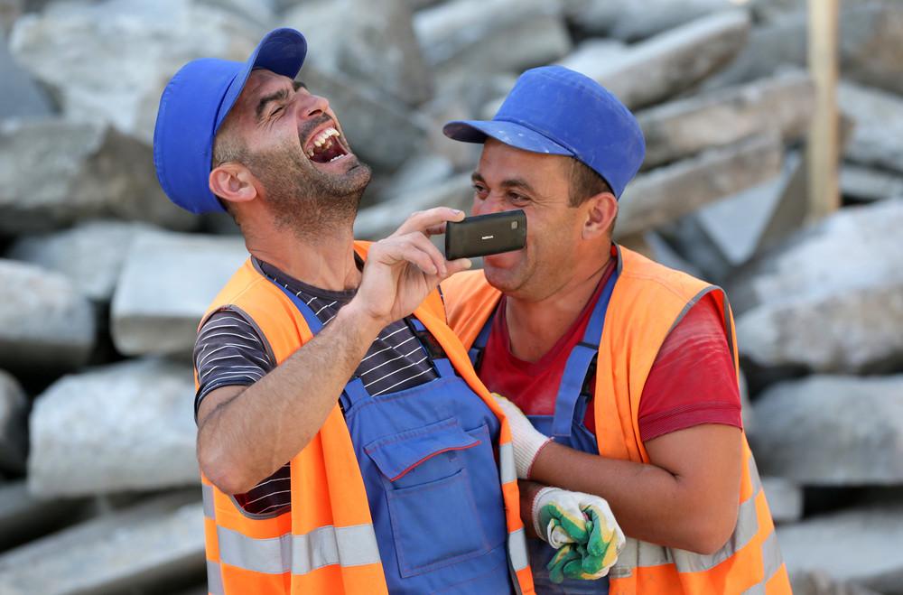 Дорожные рабочие в Москве /Фотография: Павел Смертин/ИТАР-ТАСС